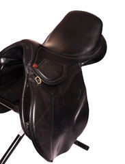 Black leather professional saddle  at black background