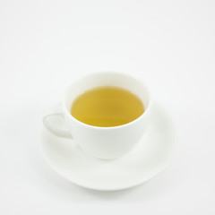 The white ceramic cup of Japanese green tea (hot drink).