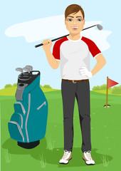 handsome male golfer with a golf club