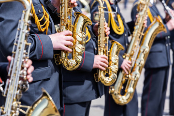 musicians of army orchestra plays his gold saxophones