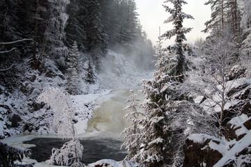 Frozen waterfall Kivach in  cloudy January day. Karelia, Russia