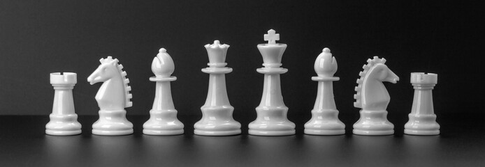 White chess figures isolated on the black background. Set of chess figures.