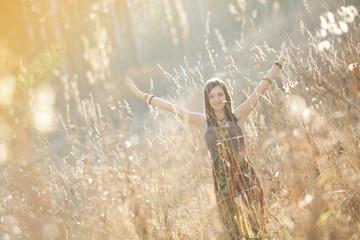 Girl in the grass in the setting sun