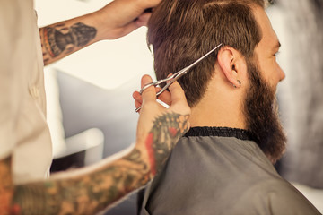 overside haircut by a professional barber.