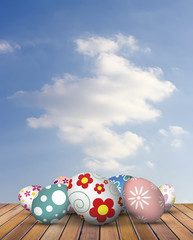 easter eggs on wood floor with sky background
