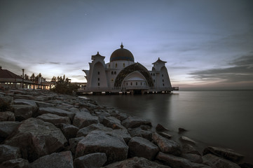 Beautiful sunrise view over a mosque. The Malacca Straits Mosque (Malay: Masjid Selat Melaka) is a mosque located on the man-made Malacca Island near Malacca City in Malacca state, Malaysia