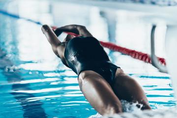 Wall Mural - Backstroke swimming race start. Toned image