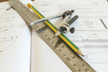 pencil with compasses and rulers on wood table