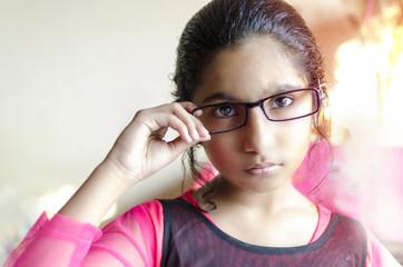 Girl wearing eyeglasses double exposure