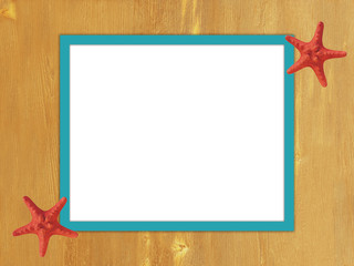 Turquoise yellow frame on wooden background with starfish.