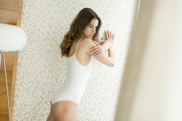 Young woman in underwear in the room