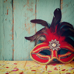 colorful Venetian masquerade mask. selective focus. vintage filtered