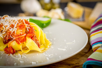Fresh pasta with tomato sauce.