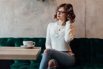 Woman sitting in a cafe