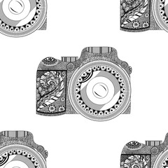 Vector monochrome seamless pattern with retro camera in hand drawn style isolated on white background with beautiful floral pattern inside. Vector