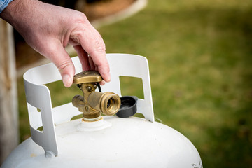 Backyard propane tank valve adjustment