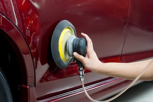 Car polishing series : Worker waxing red car