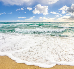sea ​​waves breaking on the sandy beach