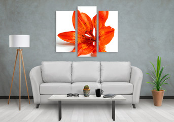 Flower on wall art canvas in three parts. Sofa, lamp, plant and table in room interior.