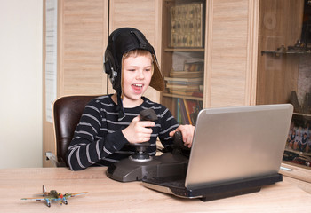 Gamer. Happy boy playing online pc game. Kid play video games.