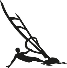 Windsurfing man lying in the wind