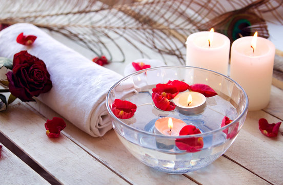 Spa relaxation with candles and roses