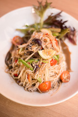 Papaya salad with rice noodle.
