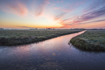 Sunrise at a Dutch farmland