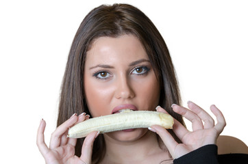 Cute brunette lady wear black shirt, holding and eating a peeled banana