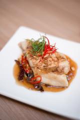 Fish in Thai tamarind sauce.