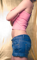 Young woman body part in short jeans