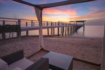 Sunset sky on the beach and pier bridge
