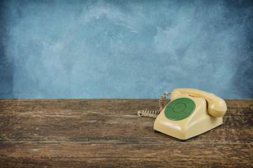 old telephone on vintage background