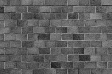 Black brick stone wall seamless background and texture