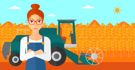 Woman standing with combine on background.