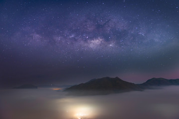 The skyline view and sunrise with the milky way at mountain with lot of fog at Phu Thok ChiangKhan Loei , Thailand.