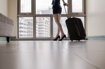 Woman arriving in a new city - travel, moving concept