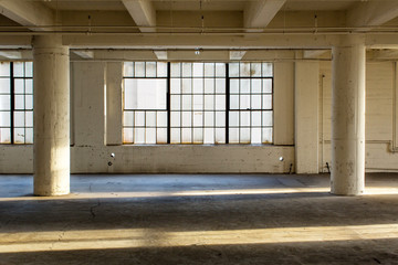 Abandoned Industrial Factory Warehouse Interior. Clean and modern empty industrial warehouse interior in California without people