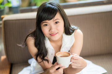 Young and pretty woman with coffee