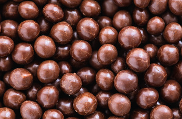 Brown chocolate  dragee balls background