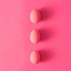 Three eggs on pink background