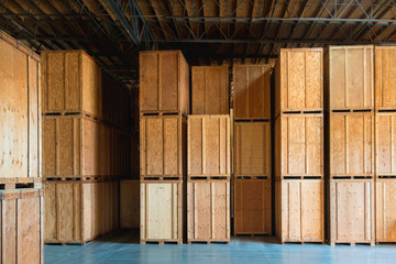 Clean Storage Warehouse with Custom Crates. Storage solutions with crates made of wood interior. Logistics and Distribution