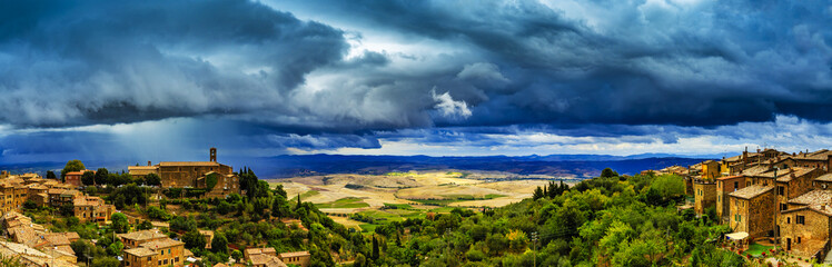 Photo sur Plexiglas Bleu jean Montalcino, old historic medieval town, Italy. Tuscan landscape in the background - panorama