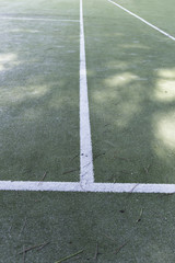 weathered empty grass tennis and football court