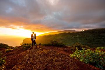 Couple enjoying beautiful sunrise