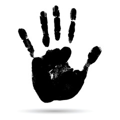 Conceptual black paint human hand or handprint of child