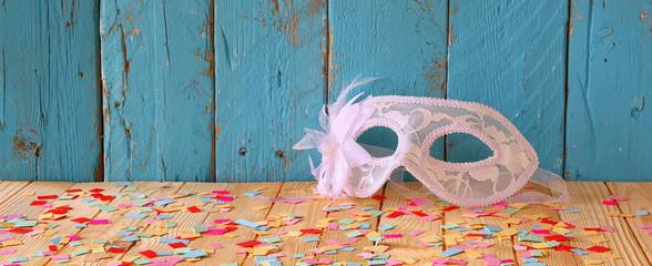 website banner background of Venetian masquerade mask. selective focus. vintage filtered