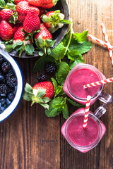 Making fresh dieting berry smoothie