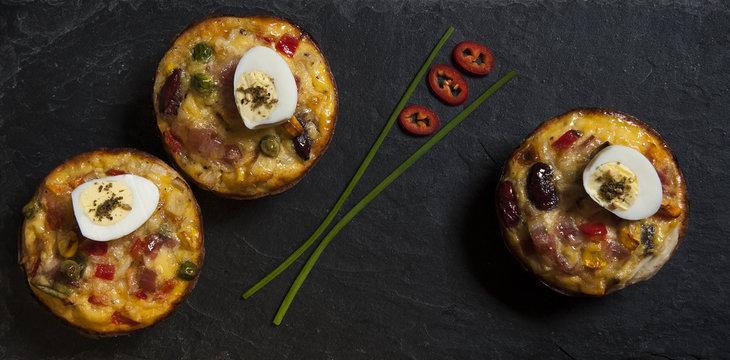 Veggie and bacon mini quiche with quail egg