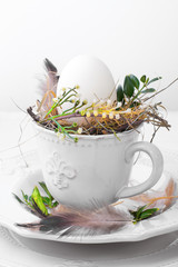 Decorating Easter egg in a cup
